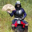 Royalty-Free Stock Photo: Samurai in armor with fan