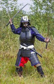 Samurai in armor with two swords — Stock Photo