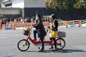 Women at tandem bicycle — Stock Photo