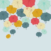 Background with collor umbrellas. Vector autumn illustration. — Stock Vector
