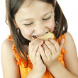 Girl eating a slice of cake — Stock Photo #10799661