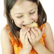 Girl eating a slice of cake — Stock Photo #10799661