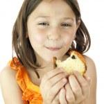 Girl eating a slice of cake — Stock Photo #10799664