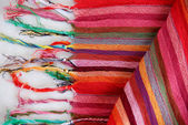 Colored Mexican tissue lined with multicolored threads. — Stock Photo