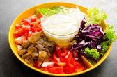 Vegetable salad in orange bowl — Стоковое фото