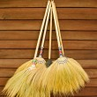 Stock Photo: Broom on wooden wall