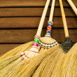 Broom on wooden wall — Stock Photo