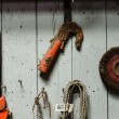 Mechanic tools hanging on wooden wall — Stock Photo #10856492