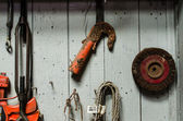 Mechanic tools hanging on wooden wall — Stock Photo