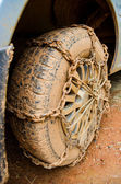 Dirty wheel with chain — Foto Stock