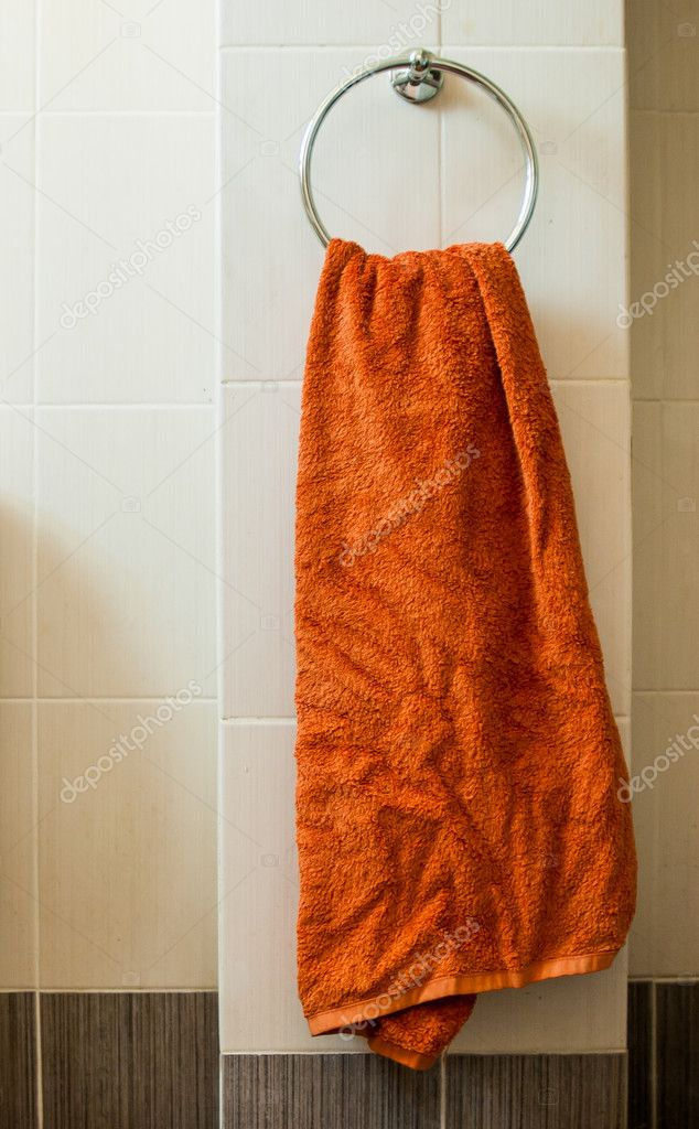 An orange towel at the bathroom — Stock Photo #10846868
