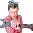 Girl with spanner — Stock Photo