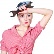 Girl with spanner wiping her brow — Stock Photo