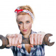 Girl with spanner — Stock Photo #11727313