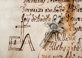 Crucifix on parchment — Stockfoto