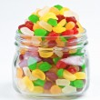 Fruit jellies in clear glass jar — Stock Photo