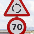 Stock Photo: Traffic signs that warn of speed limitation, and roundabout