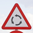 Stock Photo: Road sign that warns of a roundabout