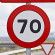 Road sign that warns of speed limitation — Stock Photo