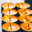 Royalty-Free Stock Photo: Plate groups candles shine in the darkness