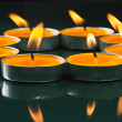 Plate groups candles shine in the darkness — Stockfoto