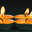 Foto de Stock  : Plate groups candles shine in darkness