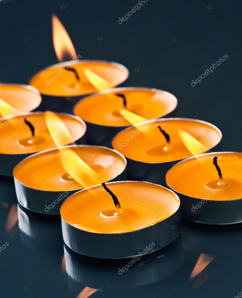 Plate groups candles shine in the darkness  Stock Photo #11862024
