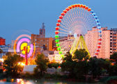Fair Ferris wheel adorned with lights at night — Stock Photo