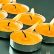 Arranged and lighted candles from dish — Stock Photo