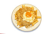 Baby eels with chips and egg — Stock Photo