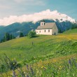 Picturesque old church in alpine landscape - Stock Photo