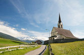 Old church in alpine landscape — Stock Photo