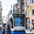 AMSTERDAM, HOLLAND - MAY 27: Tram running in the city centre amo - Stock Photo