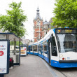 AMSTERDAM, HOLLAND - MAY 29: Tram running in the city centre amo - Stock Photo