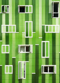 Front windows of a modern green building, green facade — Stock Photo