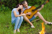 Woman and a man with a guitar — Stock Photo
