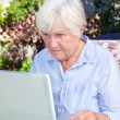 Senior Woman with Computer — Stock Photo