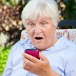 Shocked Senior Womwith Smartphone — Stock Photo #11097106