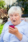 Shocked Senior Woman with Smartphone — Stock Photo