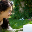 Reading in the Grass — Stock Photo