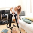 Handsome woman cleaning her living room — Stock Photo #10820293
