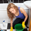 Stock Photo: Unhappy womcleaning ground
