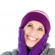 Bright woman with purple gloves and a colourful hat — Stock Photo #10820431