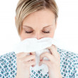 A femal patient blows her nose — Stock Photo #10820461