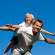 Happy father with his son on his back outdoor — Stock Photo #10820542
