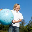 Young Kid holding a globe outdoor — Stock Photo #10820557