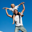 Young father with his son on his back outdoor — Stock Photo #10820569