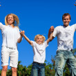 Cheerful caucasian Family Playing in the garden — Stock Photo