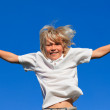 Cute Kid Jumping in the air outdoor — Stock Photo #10820578