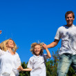 Smiling caucasian Family Playing in the garden — Stock Photo #10820600